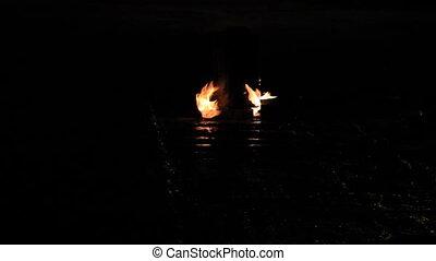 Flame lights reflection asphalt