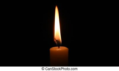 Flame of a candle on a black background