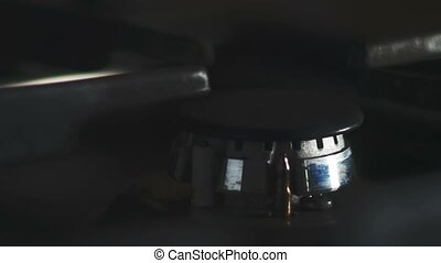 Flame of burning gas in kitchen stove. - Flame of burning...