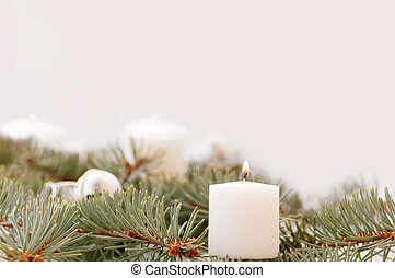 flame of the candle and fir branch on a white background