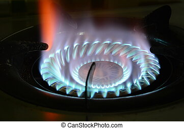 flame on gas stove in kitchen