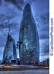 Flame Towers is a residential complex with a roof height of 190 m (620 ft) in Baku, Azerbaijan