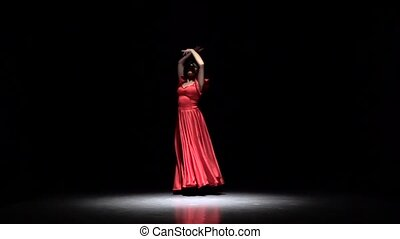 Flamenco Dance. Black background. Slow motion - Dancer in a...