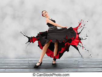 Flamenco dancer with dress turning to paint splashes on grey...