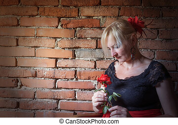 Flamenco dancer with red rose in her hand
