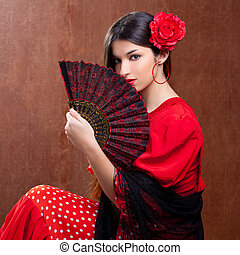 Flamenco dancer Spain woman gipsy with red rose and spanish hand fan
