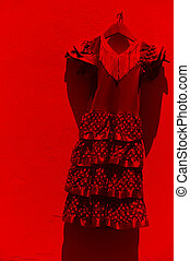 Flamenco dress hanging on a white wall in Andalusia. Spain