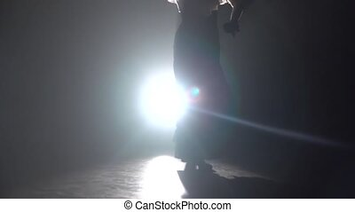 Flamenco. Girl is dancing with castanets and her leg is...