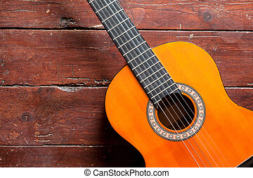 Flamenco guitar on wooden background