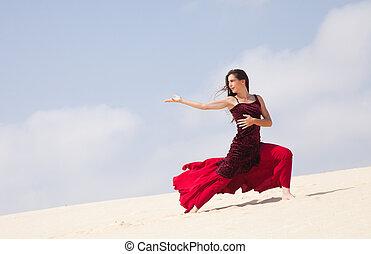 flamenco in the dunes - Flamenco dancer in the long dress in...