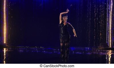 Flamenco in the rain. A passionate wet woman dances on the ...