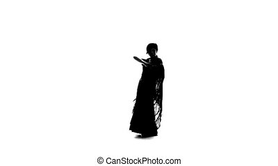 Flamenco. Woman is dancing with a manton . White background. Silhouette. Slow motion