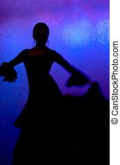 Flamenco dancer silhoete over blue background