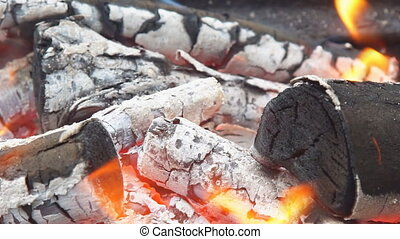 Flames and smoke from burning wood