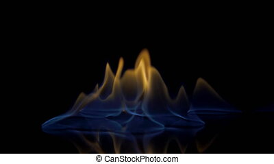 Flames burn on the mirror surface on a black background.