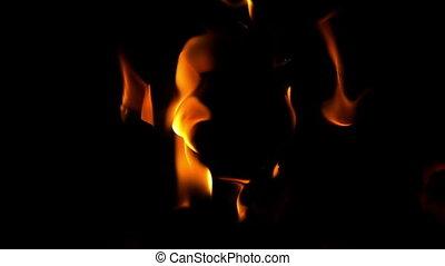 Flames burning on black background