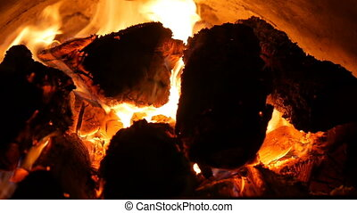 Flames enveloped the wood in iron furnace. Warm atmosphere.