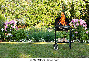 Flames in a barbecue - Flames burning in a barbecue standing...