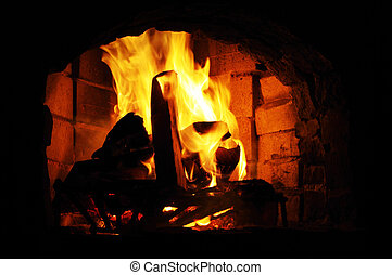 Flames in old brick fireplace