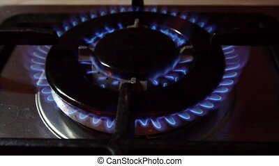 Flames in Stove Burner - Flames in a stove burner in the...