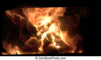 zoom to flames - flames inside woodburning stove with zoom...