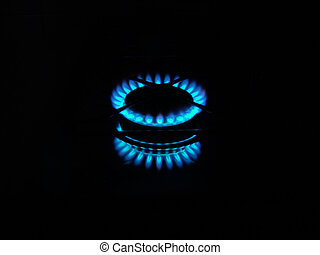 flames of kitchen gas in the dark
