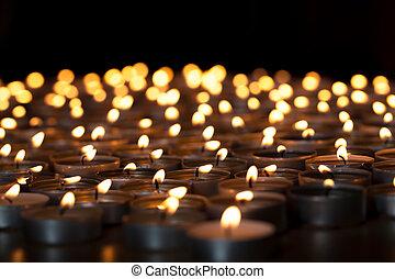Flaming candles. Spiritual image of tealights providing...