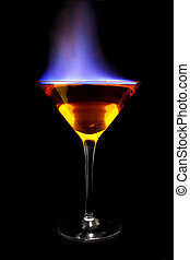 Flaming Cocktail - Flaming cocktail over black