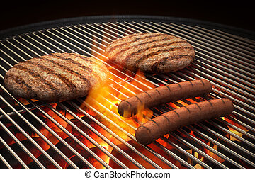Flaming Grill - Hamburger patties and hot dogs on the grill...
