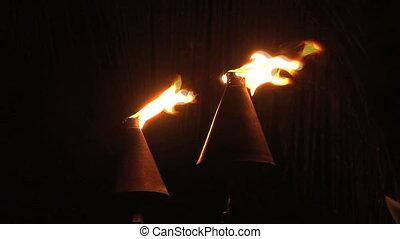 Gas powered tiki torch at night on the Big Island of Hawaii