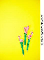 flamingo on vibrant yellow background top view