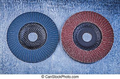 Flap grinding wheels on metallic background