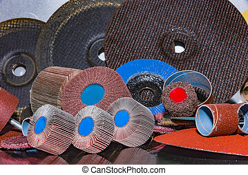 Flap Wheel. A pile of color abrasive sandpaper for metal working