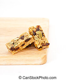 Flapjack - Pumpkin seed and raisin flapjack on a wooden ...