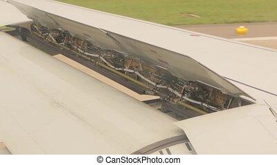 Flaps Airplane Landing - The wing flaps airplane landing...