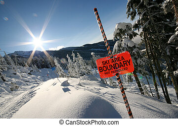 Flare - The sun shines brightly over Whistler mountain.