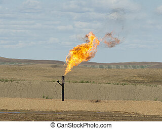 Flaring Gas - Natural gas being flared at a North Dakota Oil...