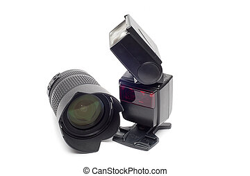 Flash and camera lens for dslr camera isolated on white background