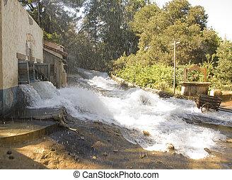 Flash Flood - Flsh flood pouring through a Mexican village