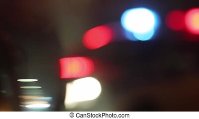 Flashers of police patrol car and traffic policeman on night street
