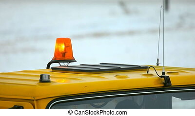 Flashing beacon. - Orange beacon on the car.