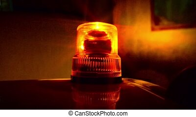 Flashing beacon. Orange flashing and revolving light on top...