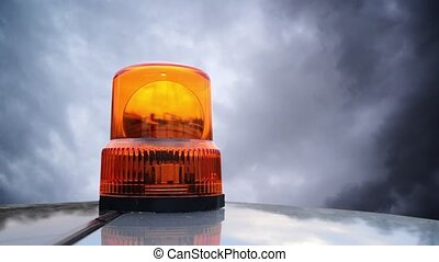 Flashing beacon. Orange flashing and rotating light on top...