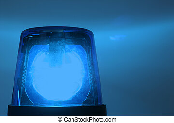 flashing blue light - Police cars drive with activated...