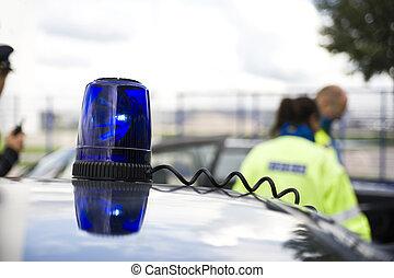 flashing light - a flashing light on a police car.