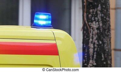 Flashing light strobe on emergency ambulance car, telephoto