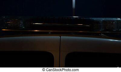 Flashing lights car escort aircraft on the platform at night...