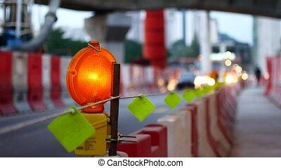 Flashing orange light, road repair work.
