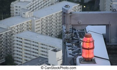 flashing red light for air traffic control at a skyscraper...
