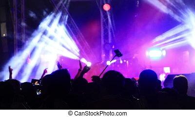 flashing spotlights at concert